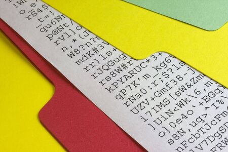 meaningless: gibberish document, meaningless computer printout, sticking out of colorful file folders