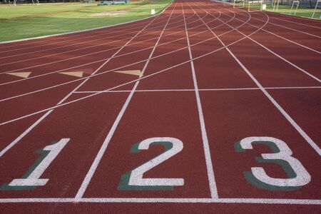 red running track with 1, 2, 3 numbers at the starting line and  green fields Stock Photo - 3184531