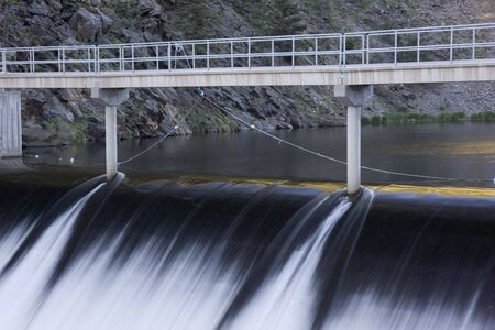 Spillway and footbridge of the Idylwilde Dam on Big Thompson River in Colorado Rocky Mountains