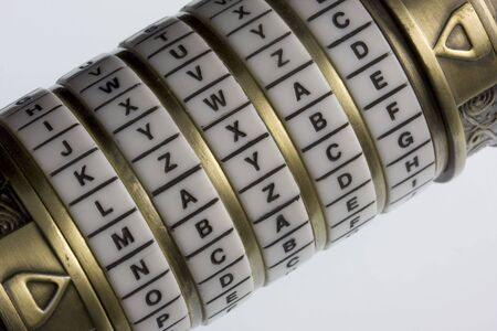 maybe: maybe - a password set on a combination puzzle box or lock with rings of letters (cryptex) , concept of uncertainty Stock Photo