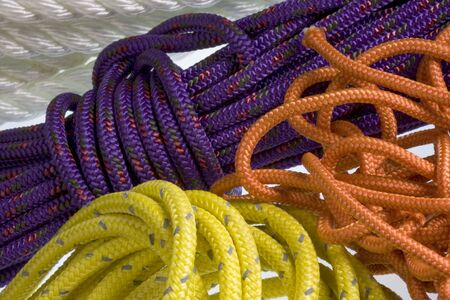 background of colorful, nylon ropes and cords coiled and chaotic Фото со стока