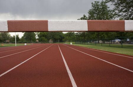 steeplechase: read running tracks with a steeplechase  barrier across them, low angle view
