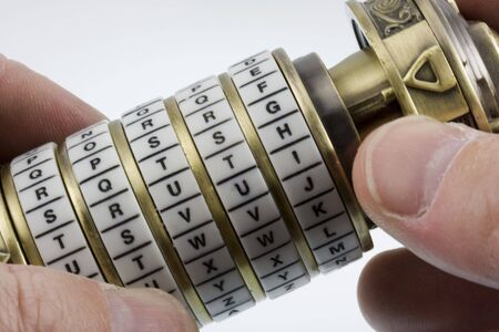 Opening a puzzle combination box with letter rings (cryptex) with truth as a secret keyword Stok Fotoğraf - 3440567