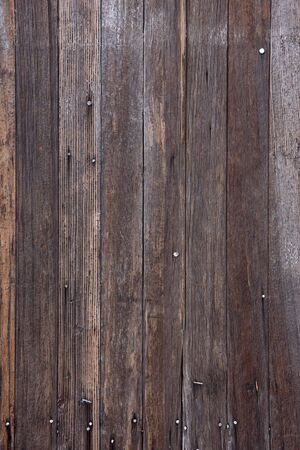 planks of weathered wood with nails and traces of white paint from old farm building Stock Photo - 3469285