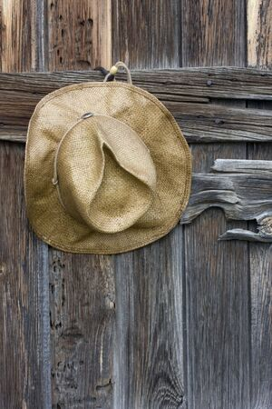 straw cowboy hat and weathered wood of old barn in Colorado Stock Photo - 3511371