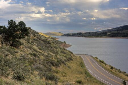 horsetooth reservoir: highway (Centennial Road) along Horsetooth Reservoir near Fort Collins, Colorado, after clearing storm