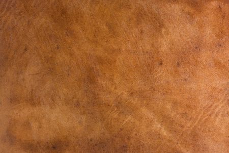 brown leather abstract from an old suitcase with scratches, marks and stains Фото со стока