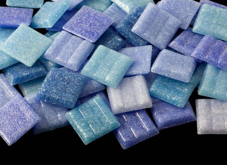 a pile of frosty glass small square mosaic tiles in different tones of blue color, black background Stock Photo - 3588167