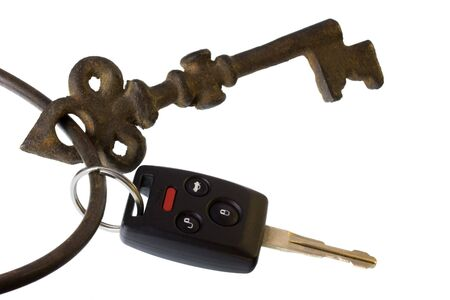 modern car key with remote and panic button on the same ring as heavy, vintage, rusty skeleton key  Stock Photo - 3665333