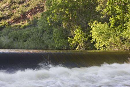 poudre river: diversion dam taking water from river for farmland irrigation; Cache la Poudre River near Fort Collins, Colorado Stock Photo