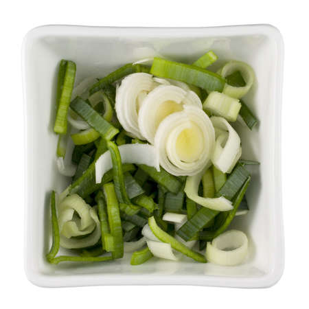 sliced leeks in a white square bowl, isolated with clipping path Stock Photo - 3689496