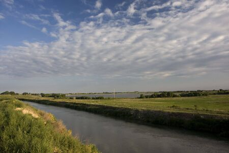 irrigation channel full of water, reservoir, and green meadows of north eastern Colorado farmland in late summer Stock Photo - 3706708