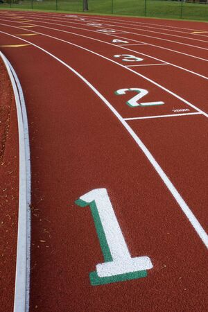 staggered: red running tracks with staggered lane numbers from one to eight
