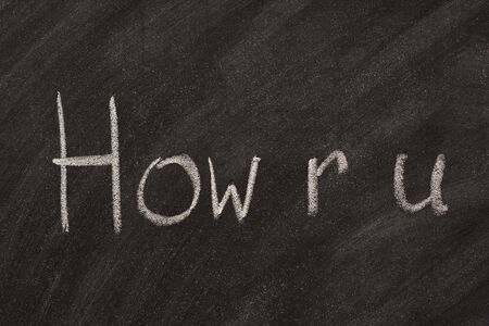 how are you in text message spelling handwritten with white chalk on blackboard Stock Photo - 3717862