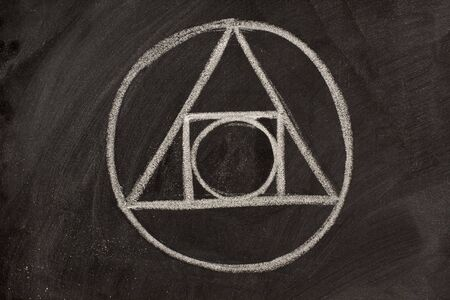 17th century alchemy symbol sketched with white chalk on a blackboard - the blending of geometric shapes, elemental symbols and astrological signs Stock Photo - 3755587
