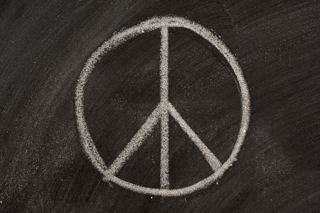 peace symbol or Nero's cross sketched with white chalk on a blackboard Stock Photo - 3755592