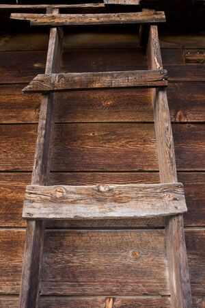 weathered wall of old barn with a primitive wooden ladder Stock Photo - 3815557