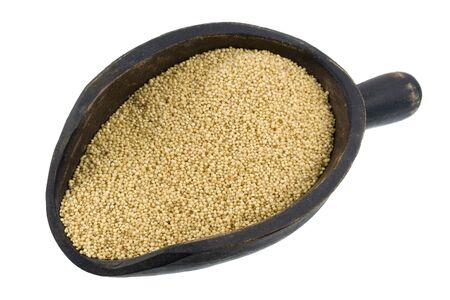 amaranth grain on a primitive, wooden scoop, isolated on white Stock Photo - 3815553