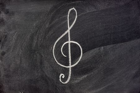 common musical notation sign, treble clef or music symbol in general, sketched with white chalk on blackboard Banco de Imagens - 3836405