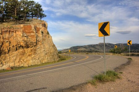 horsetooth rock: mountain road turning near Fort Collins, Colorado with Horsetooth Rock in background