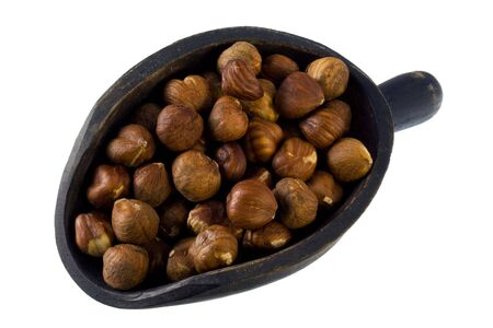 filberts (hazelnuts) on a primitive, wodden scoop, isolated on white Stock Photo - 3836393