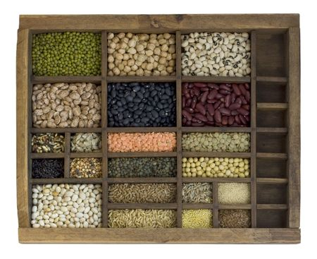 old, wooden typesetter case with assorted beans, lentils, grains and seeds Stock Photo - 3851792