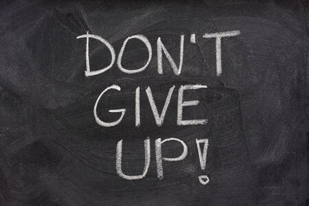 motivational phrase, don't give up, handwritten with white chalk on a blackboard Stock Photo - 3885818