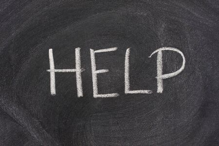 smudge: help word handritten with white chalk on a blackboard wth strong smudge pattern