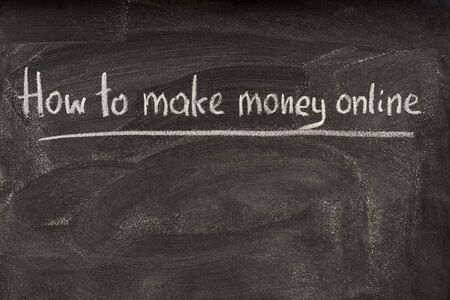 smudge: How to make money online as title of lecture or seminar, handwritten with white chalk on blackboard Stock Photo