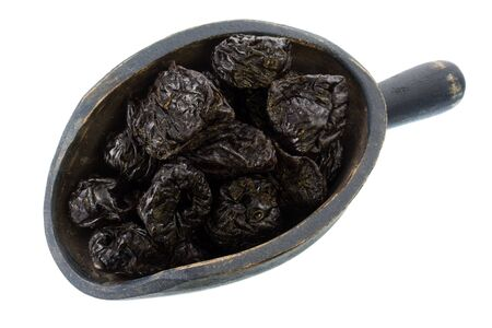 dried prunes on a rustic, wooden scoop, isolated on white Stock Photo - 3897841