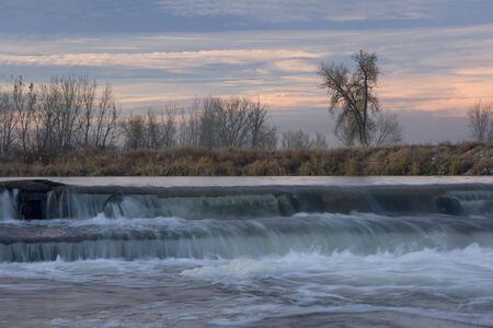 south platte river: dam on the South Platte River in north eastern Colorado near Greeley providing water for farmland irrigation, late fall, dusk