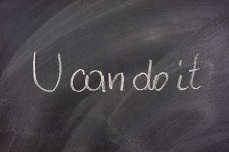 You can dot it phrase handwritten with white chalk on blackboard Stock Photo - 3925874