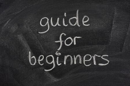 guide for beginners title handwritten with white chalk on a blackboard