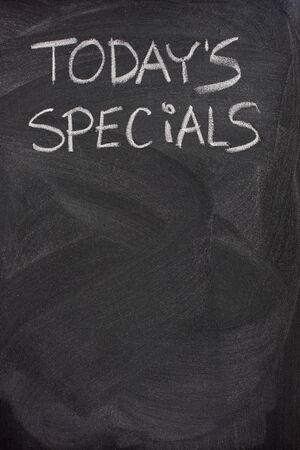 specials: todays specials title handwritten with white chalk on blackboard, copy space below