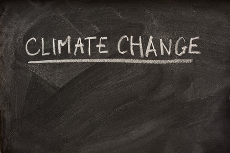 climate change handwriiten with white chalk as a title or subject on blackboard