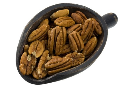 halfs of pecan nuts on a rustic, wooden scoop, isolated on white Stock Photo - 4067781