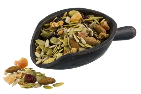 papaya flower: trail mix with pumpkin, sunflowers seeds, almonds, dried papaya,  cranberries, raisins and apples on a rustic wooden scoop isolated on white Stock Photo