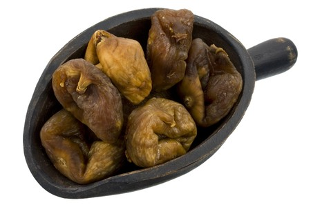 dried Turkish figs on a rustic, wooden scoop, isolated on white Stock Photo - 4082101