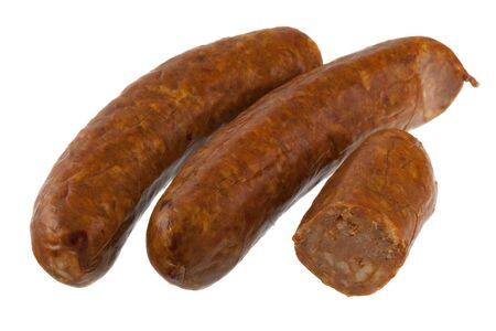 three pieces of North American (Mexican) cooked chorizo sausage isolated on white Stock Photo
