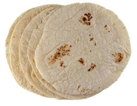 stack of wheat flour tortillas isolated on white