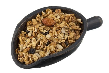 natural granola with raisins, sunflower seeds, almonds and other nuts on a rustic, wooden scoop, isolated on white Stock Photo - 4103714