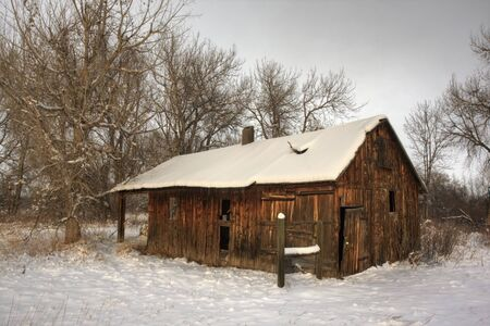 old abandoned barn or other farm building in winter scenery, Colorado Stock Photo - 4119855