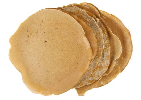 stack of homemade buckwheat flour crepes with irregular edges isolated on white