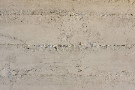 white painted concrete wall with pattern from wood planks used in construction Stock Photo - 4152641