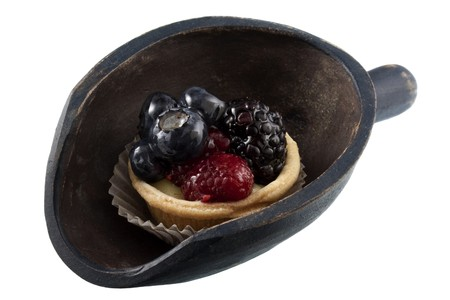 mini fruit tart with blueberries, blackberry and raspberry on a rustic, wooden scoop isolated on white Stock Photo - 4152637