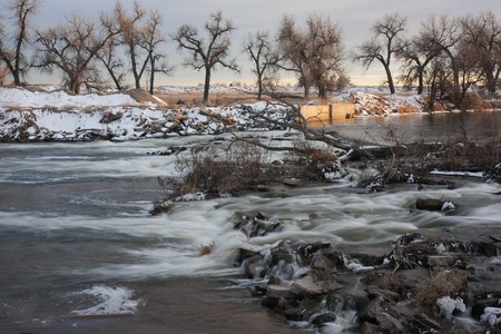 south platte river: one of many dams on South Platte River in Colorado diverting water for farmland irrigation, ditch headgate (inlet), winter scenery Stock Photo