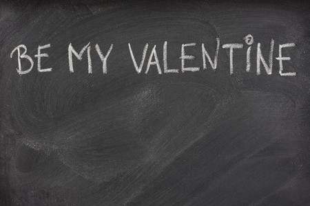 be my Valentine phrase handwritten with white chalk on blackboard with eraser smudges Stock Photo - 4167395