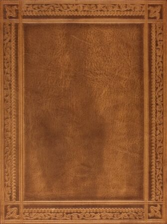 journals: brown leather book or journal cover with a decorative floral ornament