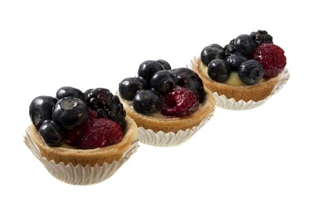 three mini fruit tarts with blueberries, raspberries and blackberries, isolated on white Stock Photo - 4183078