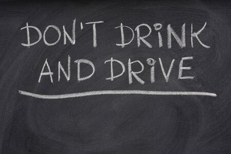 dui: do not drink and drive warning handwritten with white chalk on a blackboard